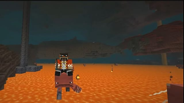 Using a saddle to ride a Strider in the Minecraft Nether update.