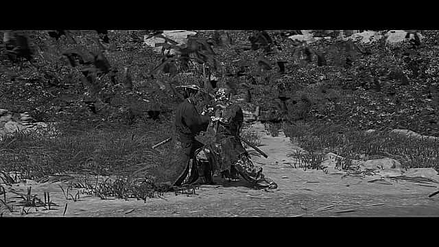Jin fighting the Tengu Demon on a beach in Kurosawa black and white mode.