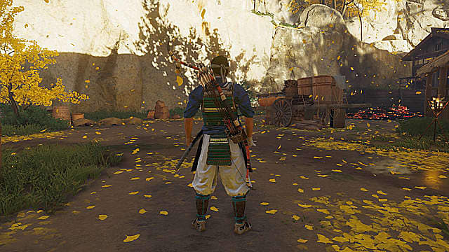 Jin Sakai standing with the halfbow on his back in an open area surrounded by yellow trees.